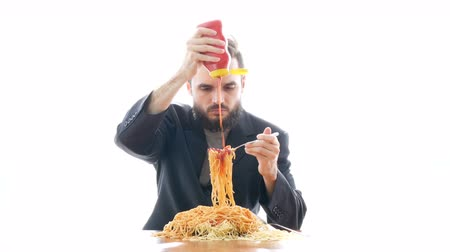 orgazm : Funny businessman eating pasta on the table. Overeating and greedy consumerism concept, studio isolated on white background.
