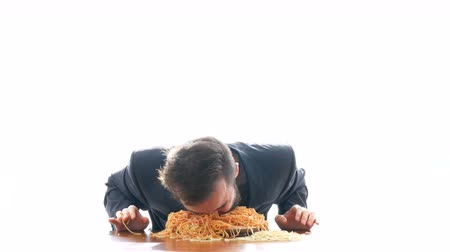 orgazm : Nasty mad businessman eating pasta with ketchup on the table. Overeating and crazy greedy consumerism concept, studio isolated on white background.