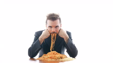 orgazm : Disgusting businessman eating pasta on the table. Overeating and crazy nasty consumerism concept, studio isolated on white background.