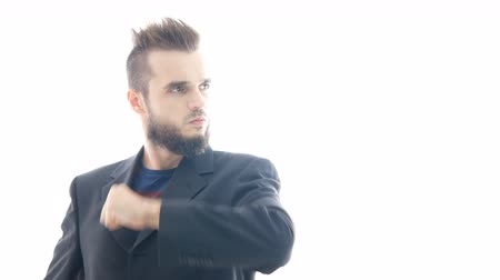 végre : Self-confident bearded man in suit gesturing well-done, studio isolated on white background. Stock mozgókép