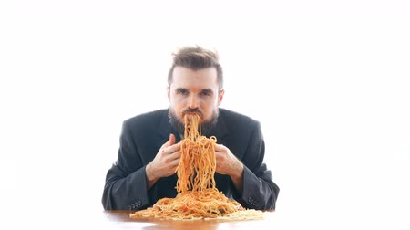 aberration : Dirty businessman eating pasta on the table. Nasty business and disgusting consumerism concept, studio isolated on white background.