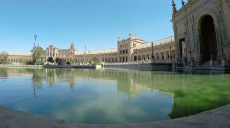 Seville, Spain - 21 September 2015: Time-lapse of river, architecture and tourists at the Plaza de Espana located in the Maria Luisa Park.