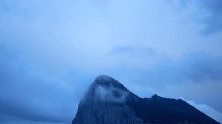 The Rock of Gibraltar with blue cloudy sky at dawn, UK. Dostupné videozáznamy