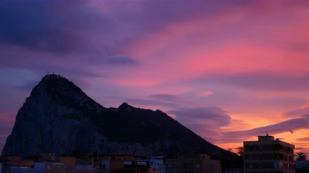 The Rock of Gibraltar and La Linea de la Concepcion skyline with colorful cloudy twilight sky in Spain.
