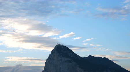 The Rock of Gibraltar with blue morning cloudy sky, UK. Dostupné videozáznamy
