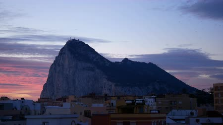 The Rock of Gibraltar with La Linea de la Concepcion cityscape and birds flying on the morning sky in Spain. Dostupné videozáznamy