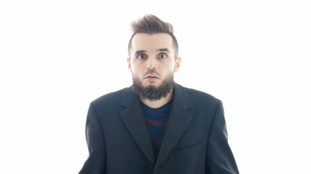 Crazy surprised bearded man in suit making funny faces and looking at you, hi-key studio isolated on white background.