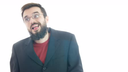Crazy nasty bearded businessman coming closer, sticking out his tongue, making funny faces and looking at you, studio isolated on white background.