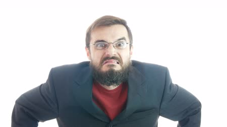 Crazy loony bearded businessman grimacing, behaving like a madman, studio isolated on white background. Dostupné videozáznamy