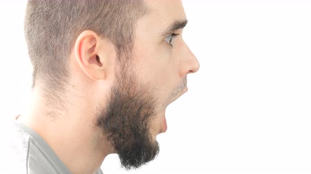 Profile of shocked bearded man face with open mouth, studio isolated on white background.