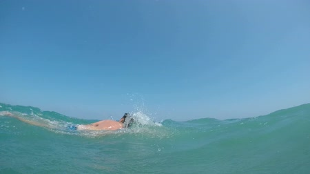 Slow-motion of a man swimming front crawl in the waves of heavy Alboran Sea in Andalusia, Spain.