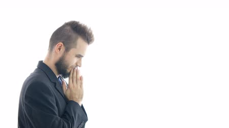 Profile of happy bearded thoughtful businessman gesturing with hands and meditating, studio isolated on white background. Dostupné videozáznamy