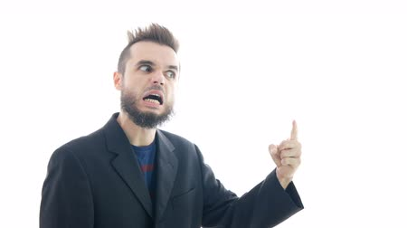 hater : Profile of crazy furious bearded man in suit going mad, studio isolated on white background.