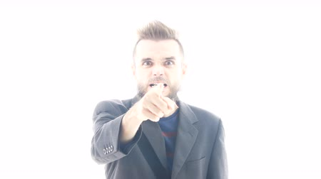 hater : Furious angry bearded man in suit going mad and pointing at you, studio isolated on white background. Stock Footage