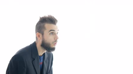 Surprised bearded businessman moving forward and backwards, studio isolated on white background. Dostupné videozáznamy