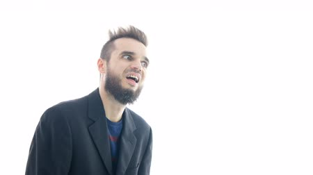 Nasty shocked bearded businessman moving forward and backwards, studio isolated on white background.