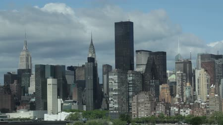 us bank tower : Midtown Manhattan skyline during spring cloudy sky in New York City, USA.