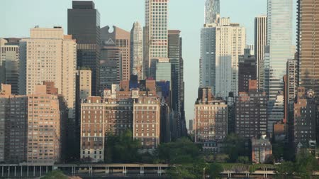 Detail of skyscrapers and morning traffic at FDR drive and East 57th Street in Midtown Manhattan, New York City, USA.