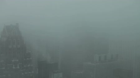 Skyscrapers detail during foggy day at Midtown Manhattan in New York City, USA.