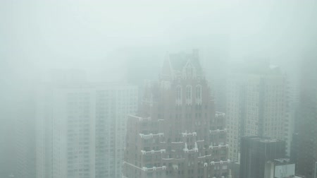 Skyscrapers detail of Midtown Manhattan during foggy day in New York City, USA.