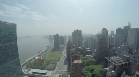 View of cityscape at Midtown Manhattan, First Avenue, FDR Drive and East River in New York City, USA.