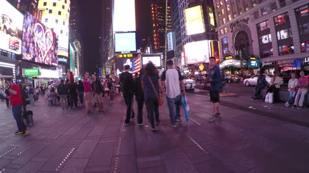 New York City, USA - 19 May 2015: People at Times Square in Midtown Manhattan at night.