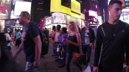 New York City, USA - 19 May 2015: Crowded Times Square in Midtown Manhattan at night.