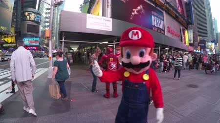 New York City, USA - 19 May 2015: People and costumed characters enjoying spring day at Times Square in Midtown Manhattan.