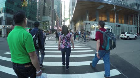 us bank tower : New York City, USA - 17 May 2015: People crossing the road at 42nd Street Bryant Park subway station in Midtown Manhattan.