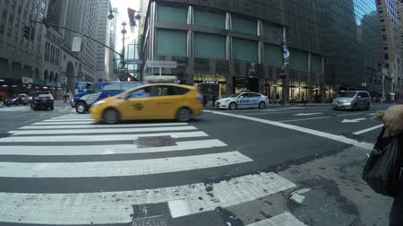 New York City, USA - 17 May 2015: Cars and people crossing the road at Lexington Ave and East 42nd Street in Midtown Manhattan.