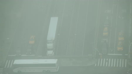 New York City, USA - 19 May 2015: Traffic during smoggy day on the First Avenue, East 42nd Street and FDR drive on Midtown Manhattan.
