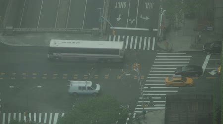 New York City, USA - 19 May 2015: Traffic during smoggy day on the crossroad of First Avenue and East 42nd Street on Midtown Manhattan.