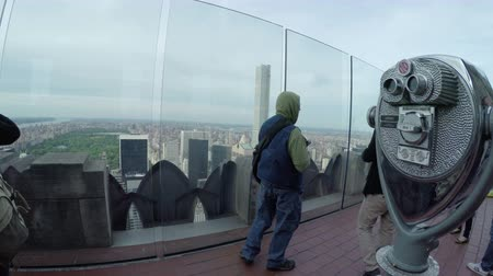 New York City, USA - 20 May 2015: Tourists looking north from the Top of the Rock Observation Deck at Rockefeller Center skyscraper on Midtown Manhattan.