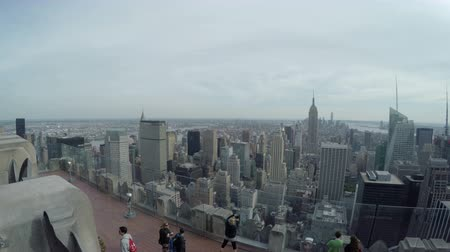 New York City, USA - 20 May 2015: Tourists looking south from the Top of the Rock Observation Deck at Rockefeller Center skyscraper on Midtown Manhattan. Dostupné videozáznamy