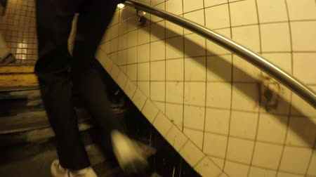 New York City, USA - 20 May 2015: People walking up the stairs and leaving New York City Subway station on Manhattan. Dostupné videozáznamy