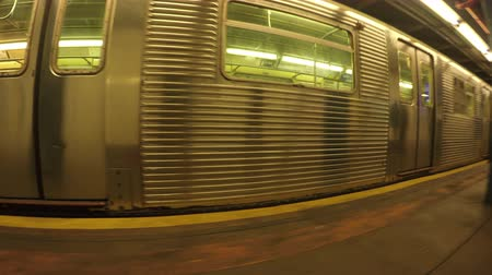New York City, USA - 20 May 2015: NYC train leaving subway station on Manhattan.