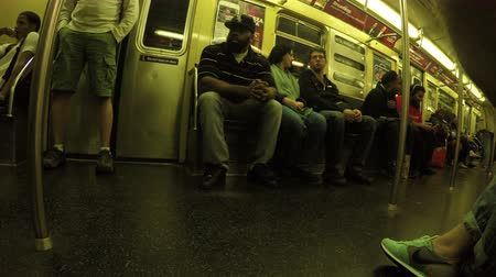 New York City, USA - 20 May 2015: Passengers sitting inside NYC subway train on Manhattan.