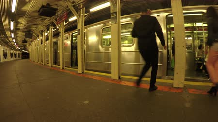 New York City, USA - 20 May 2015: Passengers and NYC subway train on Midtown Manhattan.