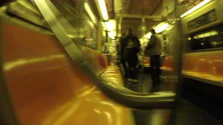 New York City, USA - 20 May 2015: Passengers getting off and on NYC subway train in Midtown Manhattan.
