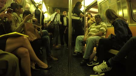 New York City, USA - 20 May 2015: Passengers inside NYC subway train on Midtown Manhattan.