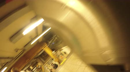 New York City, USA - 20 May 2015: Corridor and turnstiles inside New York City Subway station on Manhattan.