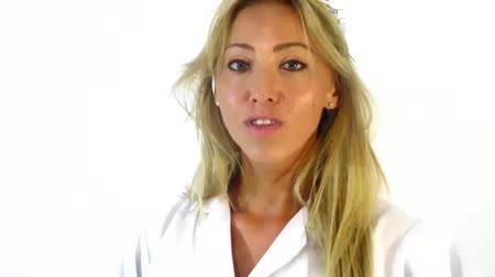 femenine : Pretty female doctor ordering silence on white background slow motion