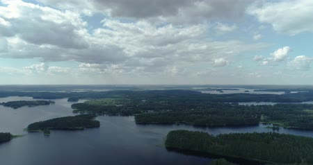 архипелаг : Punkaharju Finland, views of the area with forrest and lots of small islands surrounded with water on a sunny summer day