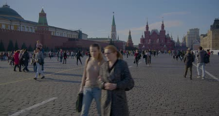 RUSSIA, MOSCOW - OCTOBER 20, 2018: People walk on red square, warm autumn day