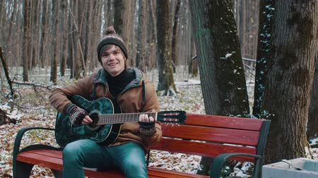 sicim : people in the Park playing guitar in winter