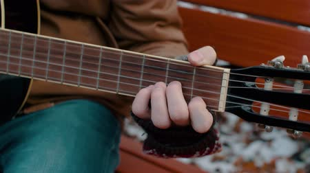 Slow Motion man in the Park plays guitar in winter