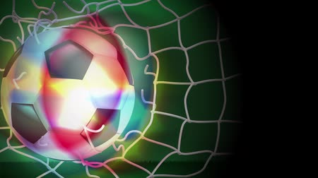 dechire : Soccer ball soared into the net and the net was torn apart out. Vidéos Libres De Droits
