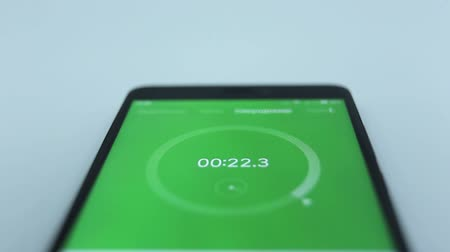 close-up of the green of digital stopwatch with white running numbers. Stopwatch on the smartphone Stock Footage