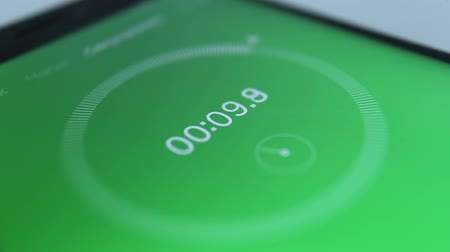 close-up of the green of digital stopwatch with white running numbers. Stopwatch on the smartphone Стоковые видеозаписи