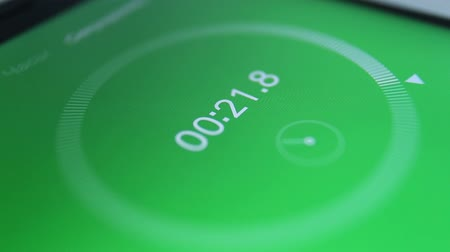 countdown leader : close-up of the green of digital stopwatch with white running numbers. Stopwatch on the smartphone Stock Footage